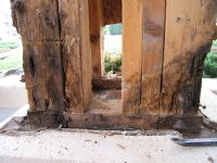 Repairs to a column of a porch due to water damage.
